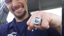 High school football team awarded disabled janitor with football championship ring