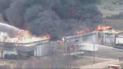 Multiple alarm foam recycling plant fire sends up a large plume of smoke in Tarrant County