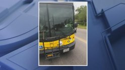 A stray bullet nearly misses a Dallas Area Rapid Transit bus driver