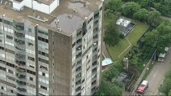 Firefighters help elderly residents evacuate during Dallas's 15-story apartment fire