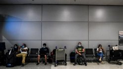 US to keep existing COVID-19 international travel restrictions, citing virus surge