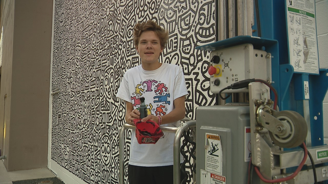 18-year-old Highland Park High School student paints an intricate mural in Downtown Dallas