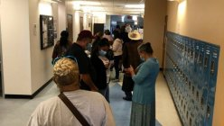 Early voting starts with long lines at some polling places