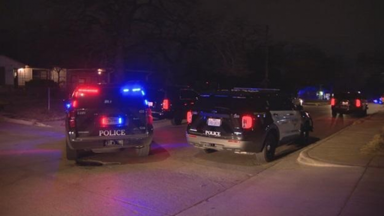 Police officers investigate after a woman was fatally shot in Fort Worth