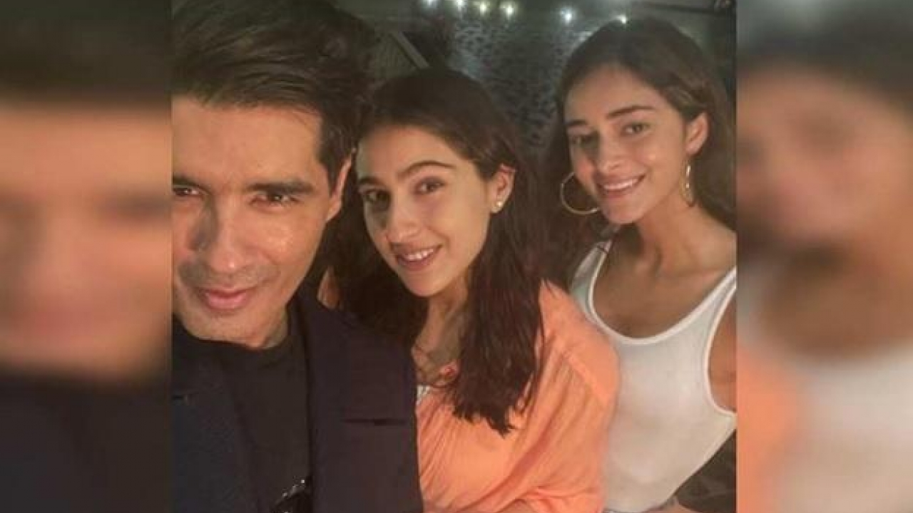 Sara Ali Khan and Ananya Panday pose for selfies with Manish Malhotra at a party