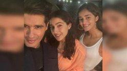 Sara Ali Khan and Ananya Panday pose for selfies with Manish Malhotra at a party